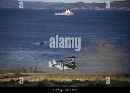 U.S. Marine Corps MV-22 Ospreys, assigned to the 24th Marine Expeditionary Unit, fly during the Exercise Trident Juncture 18 joint-capability demonstration near Trondheim, Norway, Oct. 30, 2018. Trident Juncture, a NATO-led exercise, hosted by Norway, will include around 50,000 personnel from all 29 NATO countries, as well as Finland and Sweden, and will test NATO's collective response to an armed attack against one Ally, invoking Article 5 of the North Atlantic Treaty. (U.S. Marine Corps photo by Lance Cpl. Joseph Atiyeh/Released) - Stock Photo