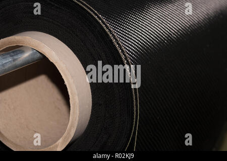 Carbon fiber rolled weave composite material industry - Stock Photo