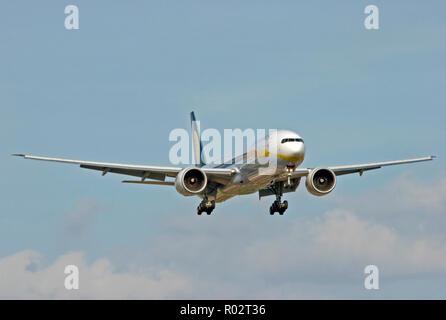 Jet Airways Boeing 777-35RER landing at London Heathrow airport. - Stock Photo