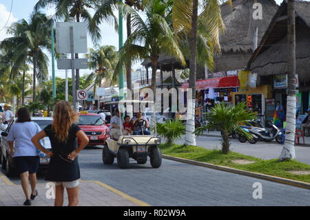 Walk through the streets of Islas Mujeres in a golf cart. - Stock Photo