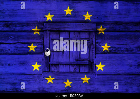 Locked europe, padlock on a closed old wooden door painted with the flag of the European Union, selected focus - Stock Photo