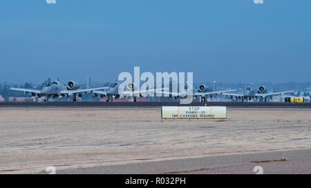 "SAN DIEGO (Oct. 31, 2018) Four U.S. Air Force A-10 Thunderbolt IIs from the 354th Fighter Squadron ""Bulldogs"" taxi Naval Air Station North Island during Phoenix Fire 2018. The ""Bulldogs"" supported Phoenix Fire from Davis-Monthan Air Force Base, Ariz., amplifying this small-scale littoral combat exercise. Phoenix Fire was conducted in Southern California by Helicopter Sea Combat Weapons School Pacific to enhance combat readiness through robust, realistic training while providing joint and combined partners the ability to work with multiple assets in a maritime and littoral environment. U.S. Nav - Stock Photo"