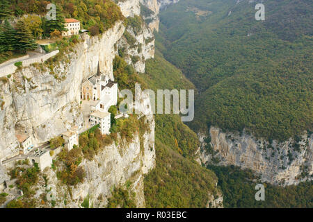 SANCTUARY ON A LEDGE ON A CLIFF FACE (aerial view from a 6-meter mast). Sanctuary of Madonna della Corona. Spiazzi, Province of Verona, Veneto, Italy. - Stock Photo