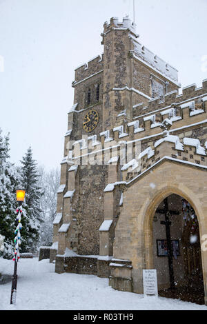 The Parish Church of St Peter and St Paul, in the market town of Tring, Hertfordshire, England, covered in snow during winter blizzard - Stock Photo
