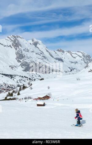 Child skiing, Le Grand-Bornand, Haute-Savoie, France, Europe, - Stock Photo
