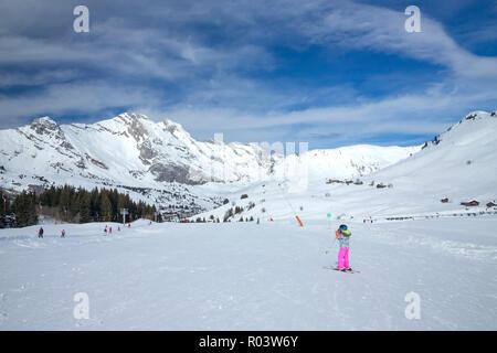 Small child skiing, Le Grand-Bornand, Haute-Savoie, France, Europe, - Stock Photo