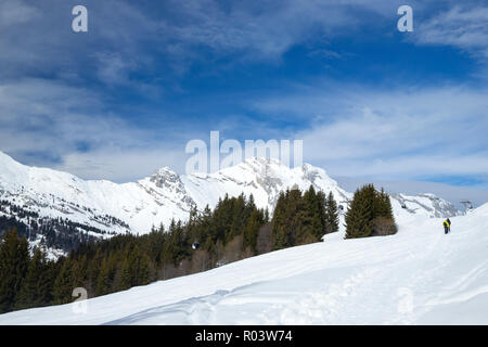 Couple snowshoeing in Le Grand-Bornand, Haute-Savoie, France, - Stock Photo
