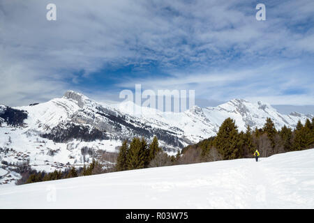 Woman snowshoeing in Le Grand-Bornand, Haute-Savoie, France, - Stock Photo
