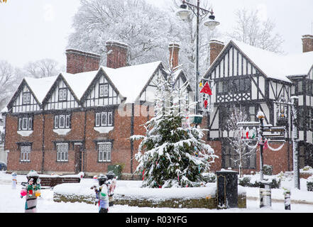 Tudor-style, half-frame buildings on the High Street in the market town of Tring, Hertfordshire, England, covered in snow during winter blizzard - Stock Photo