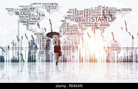 Elegant businesswoman standing with back and looking at modern b - Stock Photo