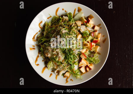 A fresh green salad with nuts, seeds and apple - Stock Photo