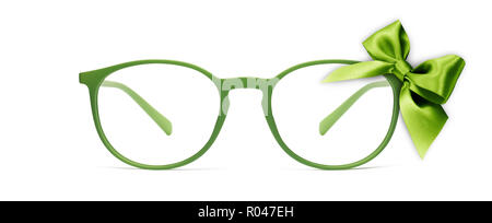 christmas eyeglasses gift card, green spectacles and green ribbon bow, isolated on white background - Stock Photo