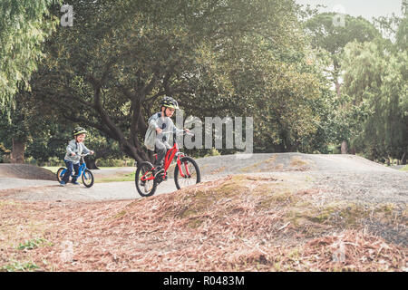Two australian kids riding their bicycles on special bike track in Adelaide, South Australia - Stock Photo