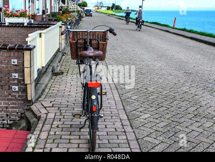 Bicycle on the street of the Dutch village. - Stock Photo