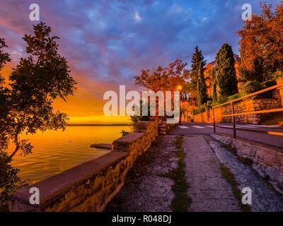Evening warm natural colors on seaside near sea on promenade park - Stock Photo