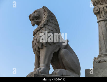 Stone Lion. A bronze statue of Stephen I of Hungary mounted on a horse, erected in 1906, can be seen between the Bastion and the Matthias Church. - Stock Photo