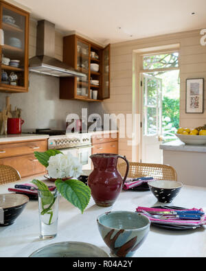 Dining area in country style kitchen - Stock Photo