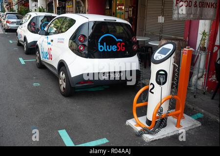 Singapore, Republic of Singapore, electric vehicle at a charging station - Stock Photo
