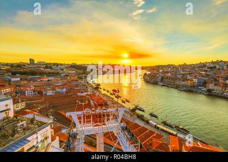 Cable car at sunset on Douro River. Vila Nova de Gaia in Oporto, Portugal. - Stock Photo