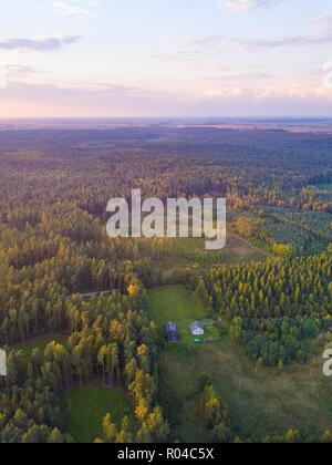 Aerial: FIelds in sunset light. Drone view - Stock Photo