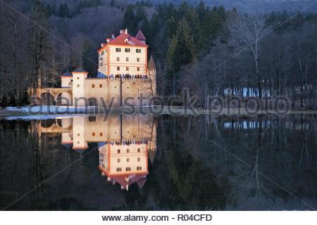Sneznik Castle reflected in winter floodwater, near Kozarisce, Notranjska, Slovenia - Stock Photo