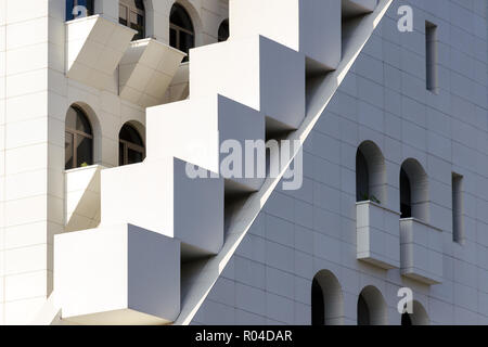 Mixing of forms and shapes, layering in modern architecture - part of facade building, unusual geometrical exterior, complex structure. - Stock Photo