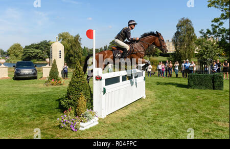 Andrew Nicholson and JET SET IV during the cross country phase of the Land Rover Burghley Horse Trials 2018 - Stock Photo