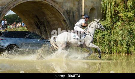 Harry Meade and AWAY CRUISING during the cross country phase of the Land Rover Burghley Horse Trials 2018 - Stock Photo