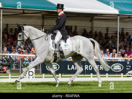 Harry Meade and AWAY CRUISING during the dressage phase of the Land Rover Burghley Horse Trials, 2018 - Stock Photo
