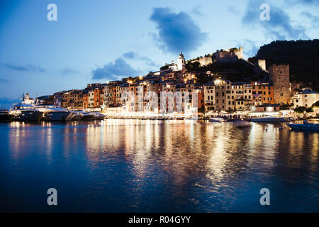 Evocative Portovenere foreshortening after the sunset - Portovenere, Liguria This photo was taken in July during the blue hour. - Stock Photo