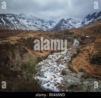 Frozen River Brittle in Glen Brittle valley, Fairy Polls tourist attraction. Isle of Skye, scottish Highlands. - Stock Photo
