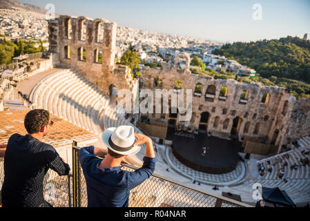 Tourists at Odeon of Herodes Atticus Theatre, by the Acropolis, UNESCO World Heritage Site, Athens, Attica Region, Greece, Europe - Stock Photo