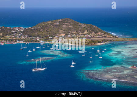 Aerial view of Union Island, looking towards Clifton and the airport, The Grenadines, St. Vincent and The Grenadines, West Indies, Caribbean - Stock Photo