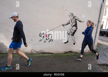 Glasgow, Scotland, 1st November 2018. A blindfolded Prime Minister Theresa May leading a British bulldog wearing a Union jack coat - a Brexit commentary street art stencilled graffiti /mural by the artist known as 'The Pink Bear Rebel', in the West End of Glasgow, Scotland, on 01 November 2018. Image Credit: Jeremy Sutton-Hibbert/Alamy News Credit: jeremy sutton-hibbert/Alamy Live News - Stock Photo