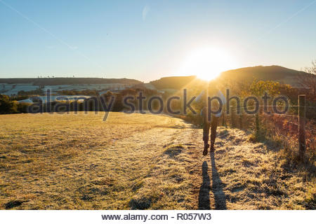 The North York Moors National Park, North Yorkshire, England, United Kingdom. 2nd November 2018. Weather: A walker at sunrise in The North York Moors National Park near Great Ayton village on a clear and frosty Friday morning. Credit: ALAN DAWSON/Alamy Live News - Stock Photo