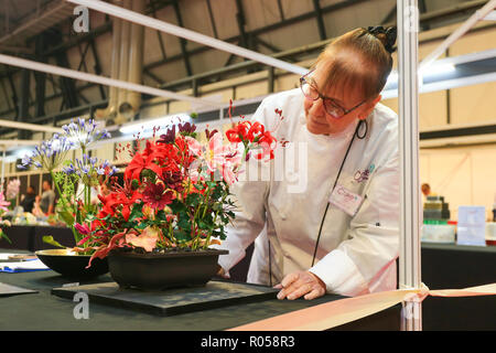 Birmingham, UK. 2nd November, 2018. The opening day of the 25th Cake International Show at the NEC in Birmingham. Hundreds of exhibitors show off their skills in sugar and cake.  Such is the skill of sugarcraft bakers this bunch of flowers is really just icing. Peter Lopeman/Alamy Live News - Stock Photo