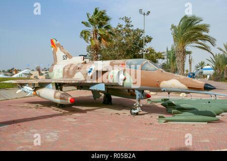 HATZERIM, ISRAEL - JAN 27, 2011: Israeli Air Force Bell Dassault Mirage Kfir fighter jet on display in the Israeli Air Force Museum. - Stock Photo