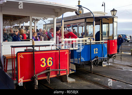 Three horsedrawn trams waiting for their horses at the tram depot in Douglas, Isle of Man - Stock Photo