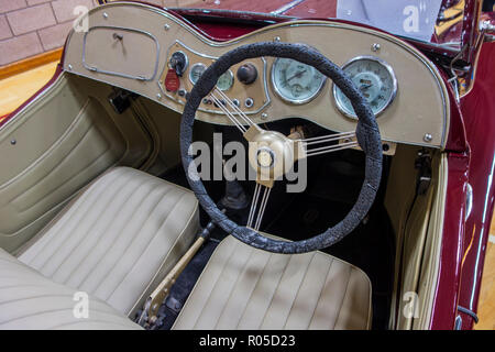 Steering wheel and dashboard of a classic British MG TD 1953 sports car - Stock Photo