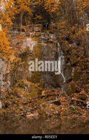 Königshütter Waterfall during autumn in Harz Mountains National Park, Germany - Stock Photo