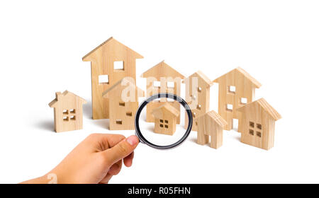 City of wooden houses on a white background. The concept of urban planning, infrastructure projects. Buying and selling real estate, building new buil - Stock Photo