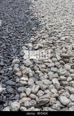 Grey and white pebbles in a Japanese zen style garden design - Stock Photo