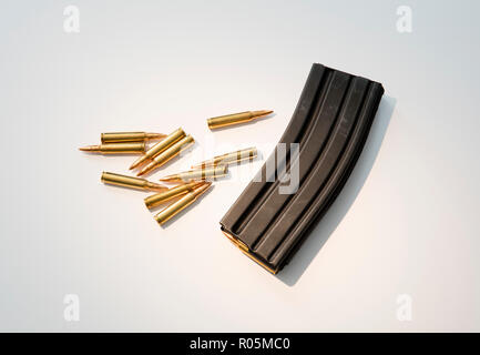 High capacity assault rifle ammunition magazine with live ammunition. - Stock Photo