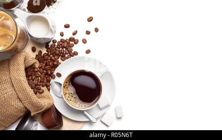 Cup of hot coffee and other ingredients over white background - Stock Photo
