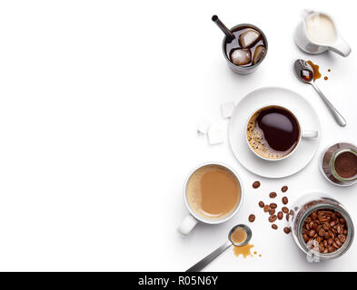 Different types of coffee and ingredients over white background with copy space - Stock Photo
