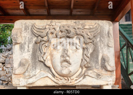 Head of Gorgon, fragment of freeze, 2nd century AD at the Apollo Temple in Didym, Tukey. - Stock Photo