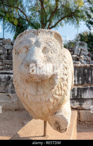 Sculpture of lion at the archaeological site of Ruins of the Apollo Temple in Didyma, Turkey. - Stock Photo