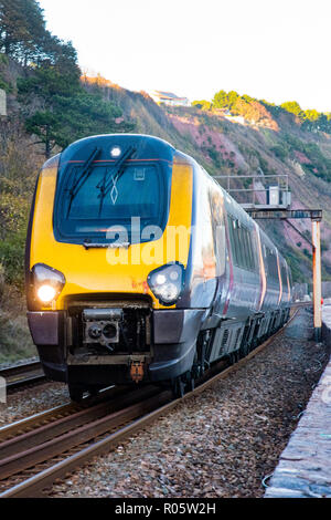 TEIGNMOUTH, DEVON, UK, 28OCT2018: Arriva Cross Country Class 220/221 Train at Holcombe, travelling towards Teignmouth. - Stock Photo