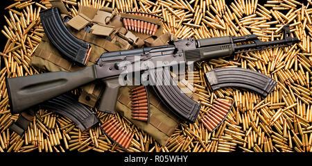 Assault rifle weapon and live ammunition - Stock Photo