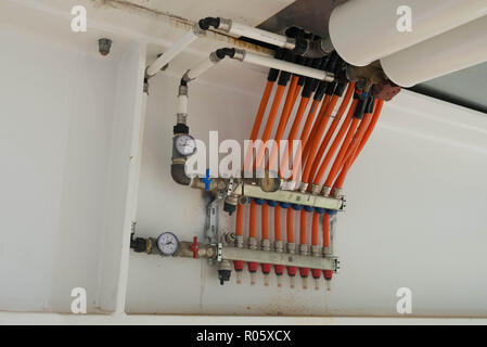 Tubes and pressure gauges on a steel construction. - Stock Photo